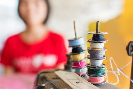 spool: Sewing threads multicolored on spool Stock Photo