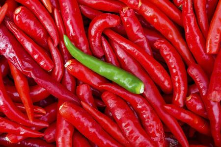 rad: Green chili in Rad chili background Stock Photo