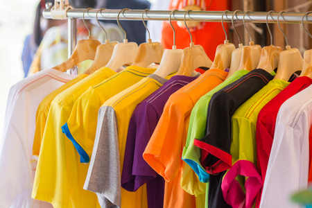 T shirts on hanger colorful Stock Photo