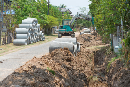 drains: Digging drains concrete pipeline on construction site