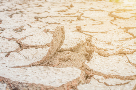 drought soil cracked with sunshine Stock Photo