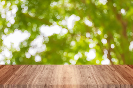 Wood top view empty on bokeh circle green leaves and tree blurred background