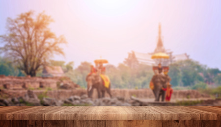 Wood top view on blurred Tourists on elephant ride tourism background. tourism concepts
