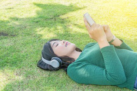 Young beautiful woman girl listening music headphones outdoor
