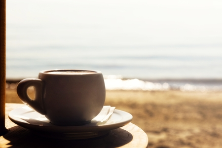 Morning cup of coffee,by the sea
