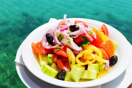 Greek salad in front of Mediterranean sea Banco de Imagens - 30440649
