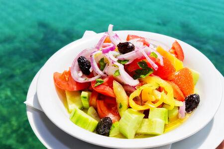 Greek salad in front of Mediterranean sea