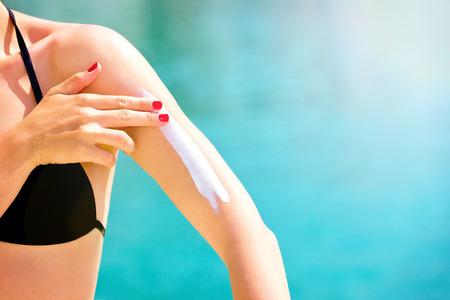 Close up of a female applying suncream
