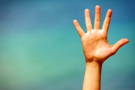 hello: Close up of a open hand, on blue background  Stock Photo