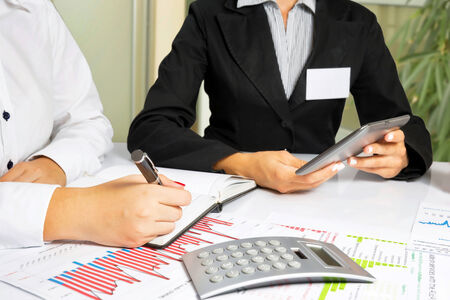 Business women doing annual report, at office desk  photo