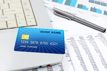 Business detail of a internet credit card,lying on top of a lap top  photo