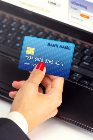 currency exchange: Businesswoman holding credit card - e banking   shopping online