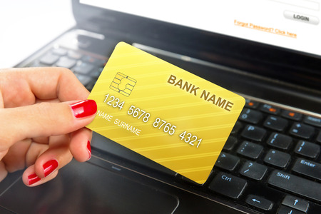 Businesswoman holding credit card while e-banking   shopping online  photo