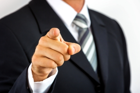 accusing: Close up of a young businessman, pointing with his finger  Stock Photo