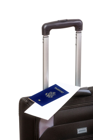 overseas visa: Close up of a black suitcase with passport on top, isolated on white background