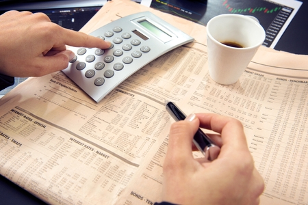 accountancy:  Business woman calculating  Stock Photo