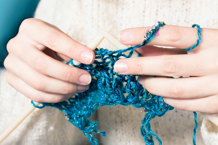 coldness: Close-up of hands knitting