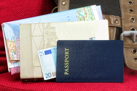 Close up of a traveling documents- passport, ticket, map and money. Stock Photo