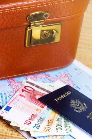 Close up of a traveling documents- passport, ticket, map and suitcase. photo