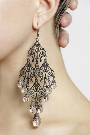 ear rings: Earring on woman. Stock Photo