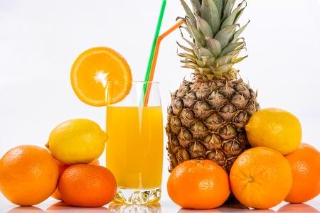 Glass of orange juice and fruits, isolated on white background. photo
