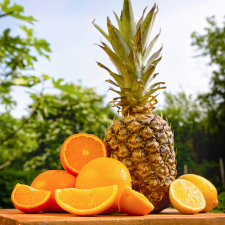 Variety of tropical fruits against nature background. photo