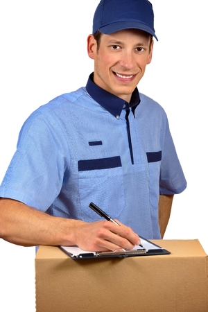 mail order: Smiling delivery man isolated on white. Stock Photo