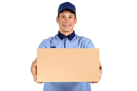 delivery service: Handsome young delivery man portrait isolated on white.