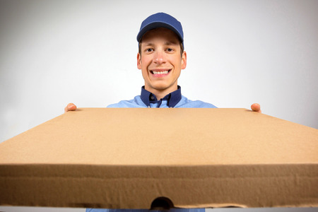 pizza delivery: Pizza delivery man. Stock Photo