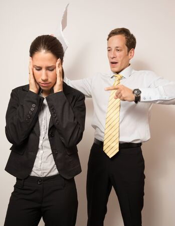 bad planning: Aggressive male manager,giving negative feedback to his female colleague.