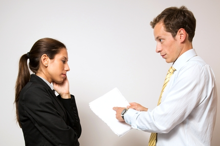 bank manager: Male manager,giving negative feedback to his female colleague. Stock Photo