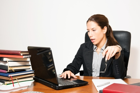 Young business dressed woman,gesturing work overload. Stock Photo