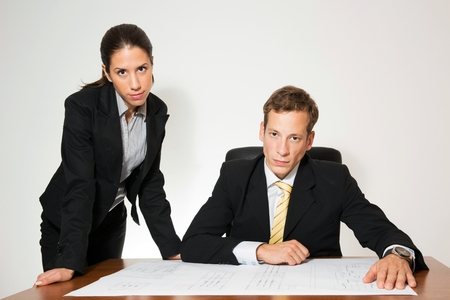 Business dressed man and woman working at the office desk. Stock Photo
