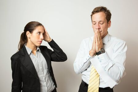 Bad feedback reaction of a male and female business dressed office workers.