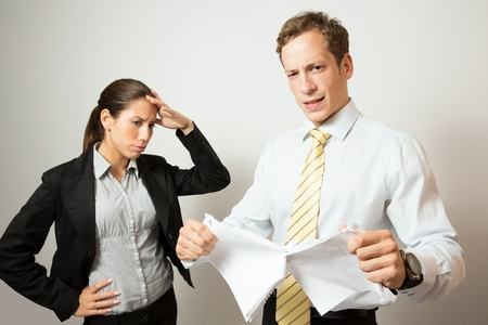 complaining: Business dressed man giving negative feedback to his colleague.