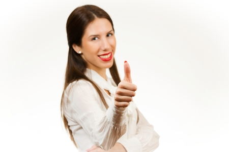 achiever: Beautiful young business woman, with her thumb up, isolated on white background.