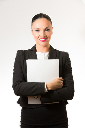 Black hair business dressed woman holding white book photo