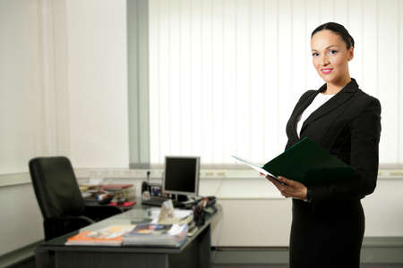 office space: Young business woman inside office space,smiling.
