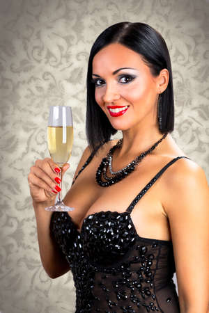 Beautiful black hair woman holding glass of champagne. photo