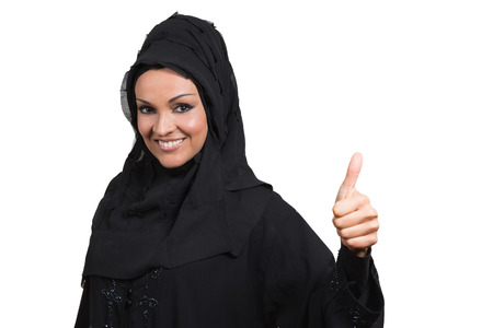 arab people: Arabic business woman,smiling and showing a thumb up, isolated on white background.