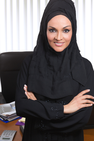 Portrait of a young beautiful Arabic business woman,inside her office. photo