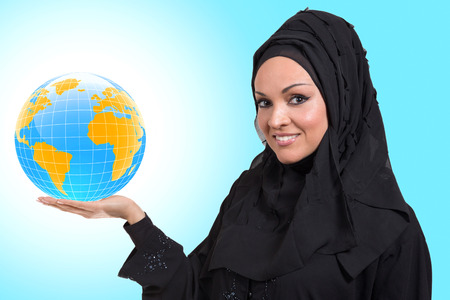 Arabic business woman,smiling and holding a globe. photo