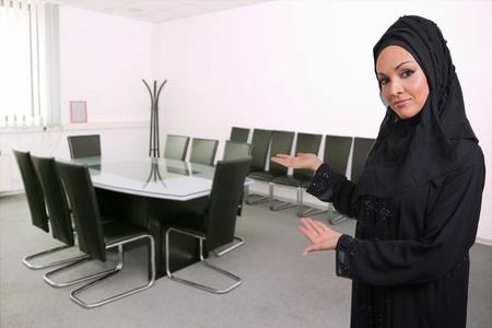 Arabic business woman,presenting a meeting room. photo