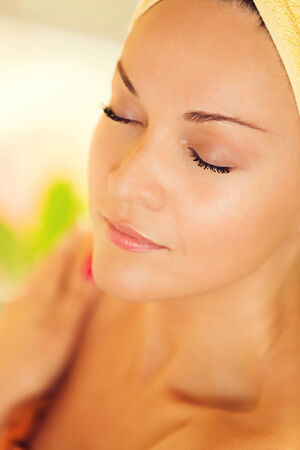 fullness: Beautiful young woman, with towel on her head, enjoining in spa treatment. Stock Photo
