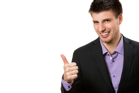 Positive young business man,showing thumb up. Stock Photo