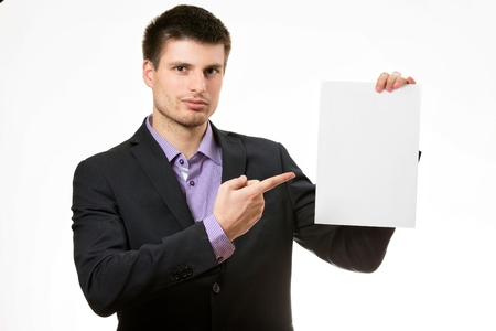 Smiling young business man,showing a white card. photo