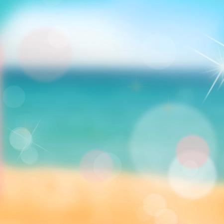 Blurred background. Sandy beach and blue sea.