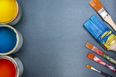 colorful paint: Colorful paint cans and brushes.