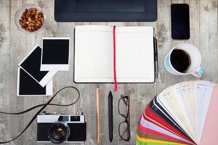 Creative concept of a designer's work office desk. Top view. Standard-Bild