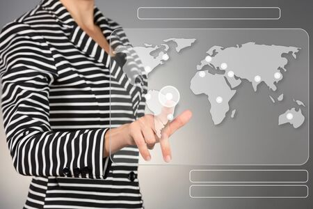 hand press: World wide connection concept. Young business woman touching screen.
